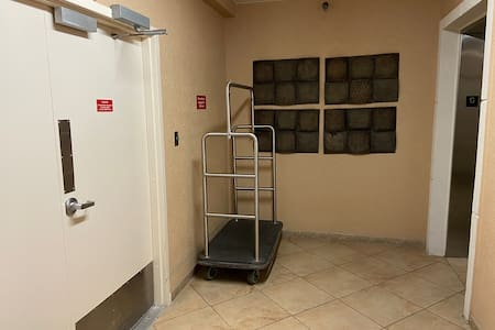 LRge double door entry from garage with luggage cart