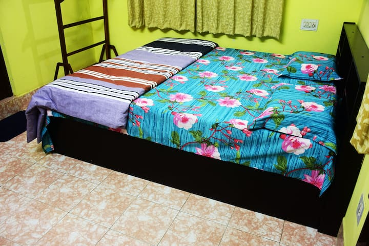 Bedroom 1 ( King size Cot with Quilt)