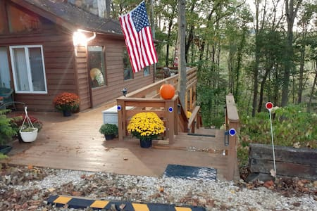 After dusk, a motion-sensor light on the corner eave of the house will go on, either as you drive to the parking stopper OR when you exit your vehicle -- and light your way down your deck stairs (right).