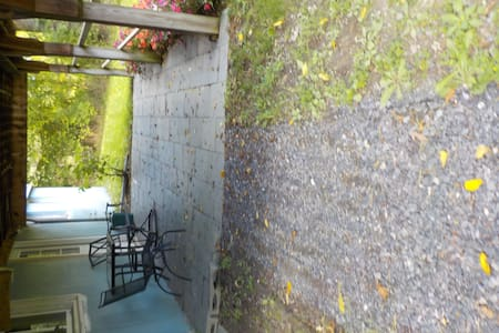 Gravel path to apartment porch and entrance.  Sorry, photo won't rotate properly when I download.