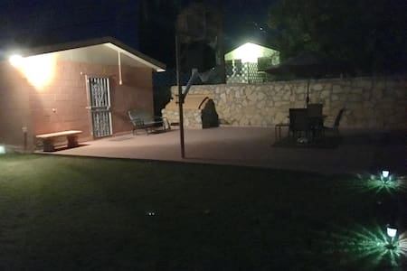 The view of the backyard with the motion sensor lights turned on.
