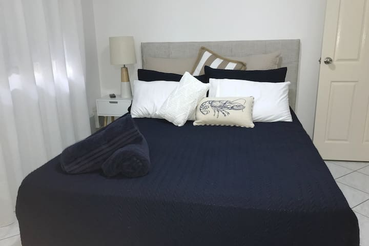 The second bedroom also features a comfortable queen-sized bed, and premium linens ready to sink in to.