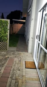 2 security lights above ranchslider , lighting up pathway  to carport. 1 security light by car port lighting up gate, pathway and carport.
