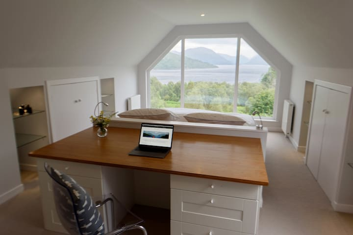Master bedroom with superking bed, ensuite and incredible view of the loch