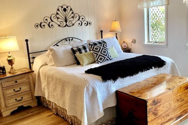 Spacious king size bed with nightstand with built-in charging stations