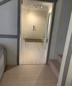Foyer/ hallway entry to family room