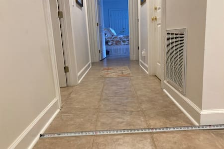 """Hallway is 45"""" wide shoe molding to shoe molding. No steps into adjoining rooms."""