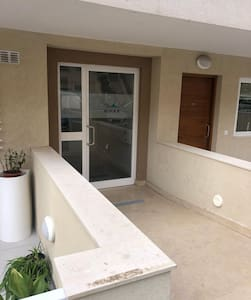 Main Entry door with slight slope