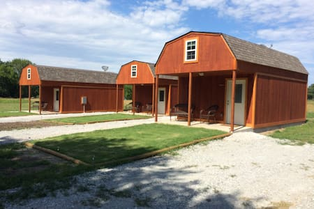 Each cottage has its own gravel parking area.  There  are 4 private gravel parking areas next to the three cottages.