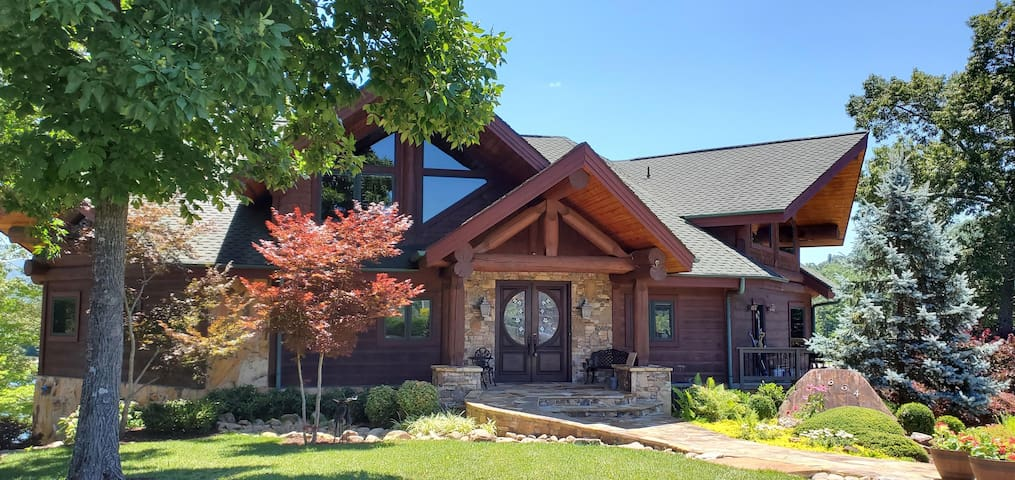 Luxury Living Lakefront Log Home with boat dock.