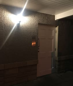 The car parking and front door are well lit