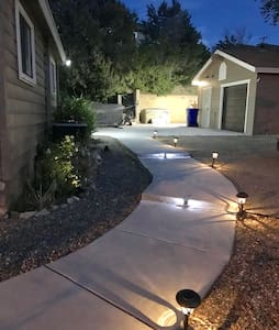 Front entry path fully lit at night