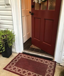 Entrance patio and interior tile is level and threshold is standard height.