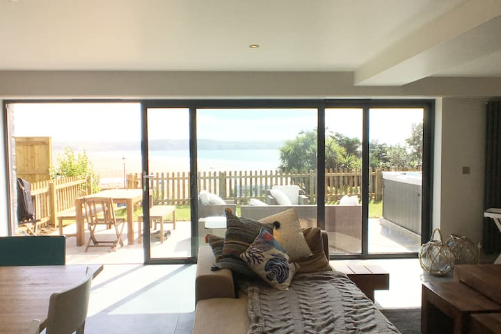 The large picture patio door allows light to flood into the space.  The view from the open plan Living space is stunning and will bring a smile to your face and leave with lasting memories of your stay.  #thatviewthough
