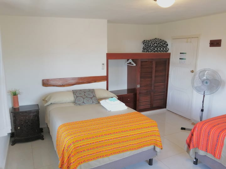Comfortable double bed room! AC, shared bathroom