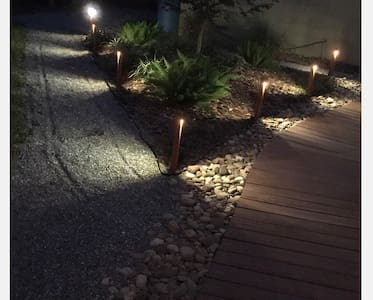 The pathway is lit up but it is a pebble pathway