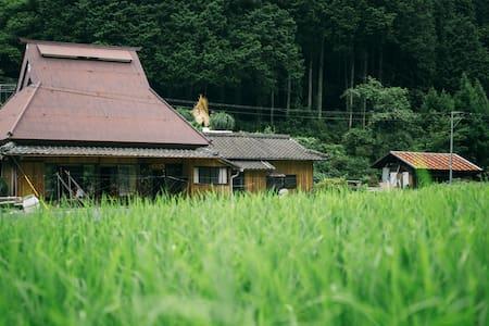 Traditional straw-roofed house. Visit Koyasan