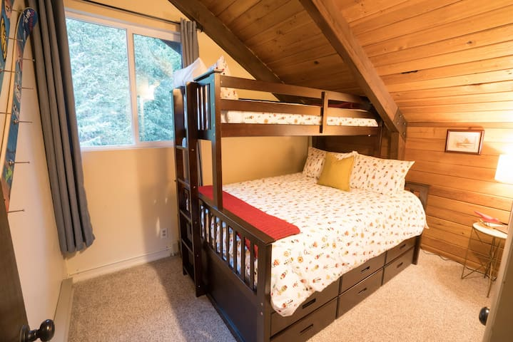 Upper Level: Queen + Twin Bunk Room. Overlooks private back deck & hot tub area