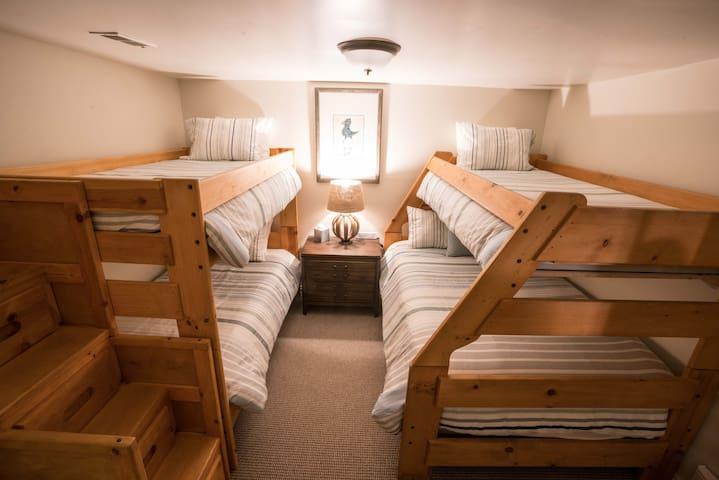 Basement Bunk Room: Sleeps 4-5.  3 Twin Beds + 1 Full Bed