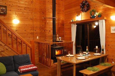 Prime Cottages duplex house Fireplace Big hot tub