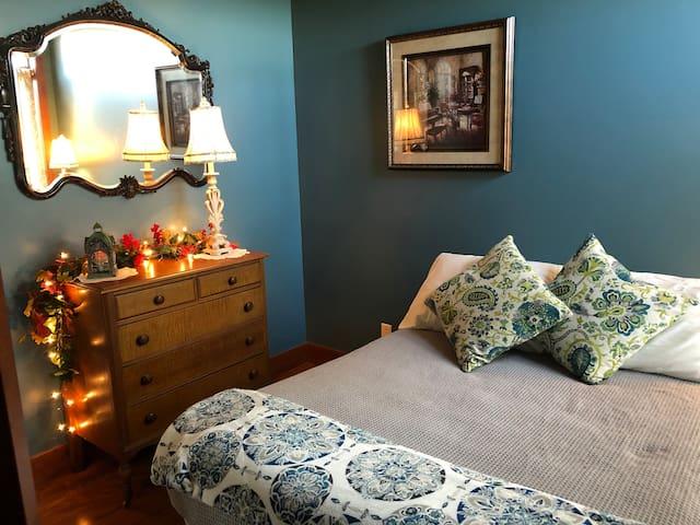 Main floor cozy bedroom with double bed.