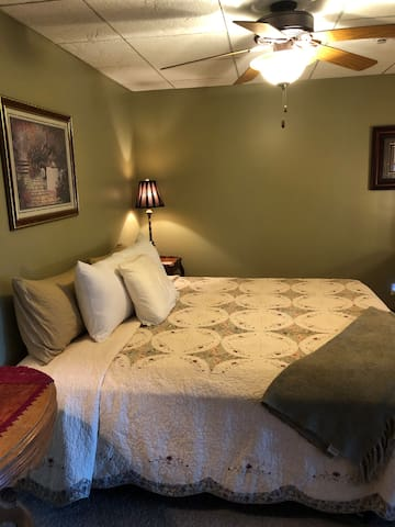 Lower level bedroom with king bed.