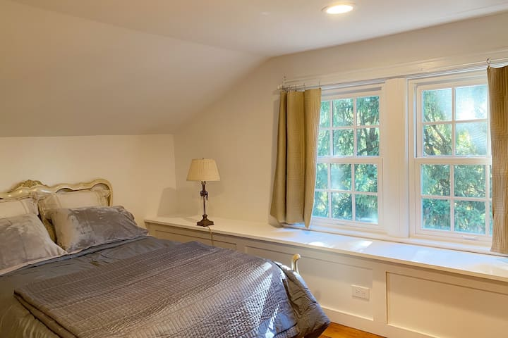 Bedroom #4 with large windows looking out into trees