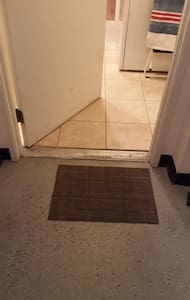 Entry from garage through laundry room then entering guest suite is all one level.  Entire unit is one level.