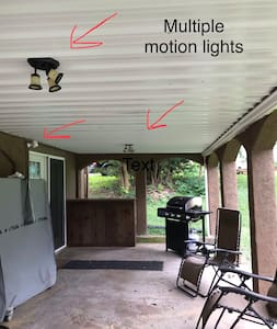 Automatic motion lights indicate clearly marked path to back door.