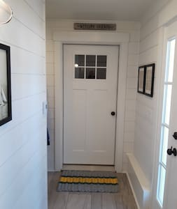 Same level entrance from outside walkway through Outside Door into Mudroom, as well as into apartment.