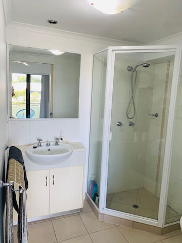 The master bedroom benefits from a private ensuite bathroom replete with a shower, toilet and mirrored vanity.