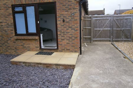 This  shows the path from the access gate beyond which is the car parking space. There is then one up from the path to the landing and another into the home.