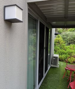 Sensor light near entrance. Other sensor lights illuminate the nearby carport