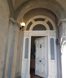There is a light switch on the left side of the front door. It will turn on the outdoor light above the entrance to the property.