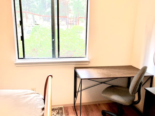 Workspace with desk and chair can be setup upon request in bedroom or living space.  Views out the window look onto the mature trees and landscaped yard.