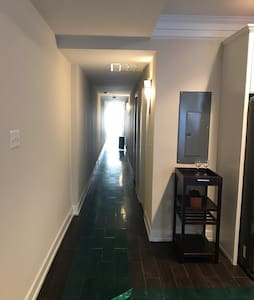 Hallway is wife enough for a wheelchair to pass without a problem