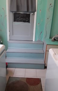 these are the stairs in laundryroom in to Airbnb