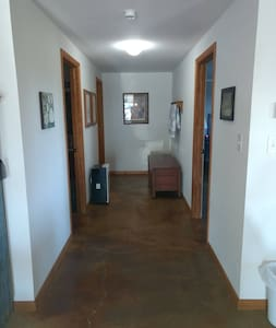 Wide hallway for easy access to bathroom, bedroom and utility room.