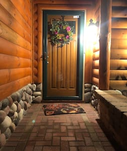 Steps to sensor lighted front door entrance way.