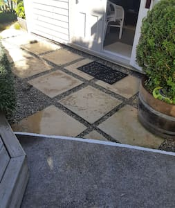There is a tiny lip from footpath to pavers and then a step to enter cottage.
