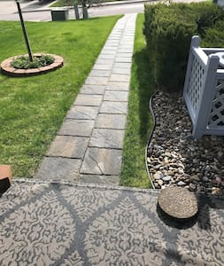 Stone path from patio to sidewalk.