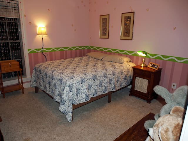 Private bedroom with queen bed and bath