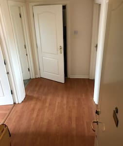 This photograph shows the main hallway of the flat. All rooms are accessed from this hallway. The hallway is 1.7 metres wide and over 3 metres long.