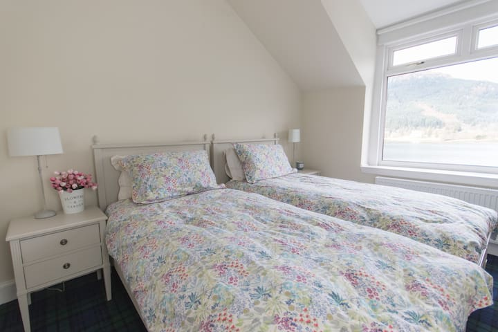 """Bedroom 1 - """"Loch Long Room"""" - Comfy twin beds with fresh sheets. Hair dryer included"""