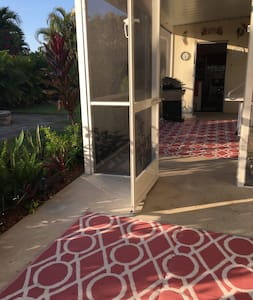 Entrance from carport to screen room