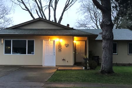 HOUSE FRONT: Your parking stall is located in the driveway on the right. Your entrance is the front door on right. The motion detection lighting gives you optimum ability to navigate day or night.