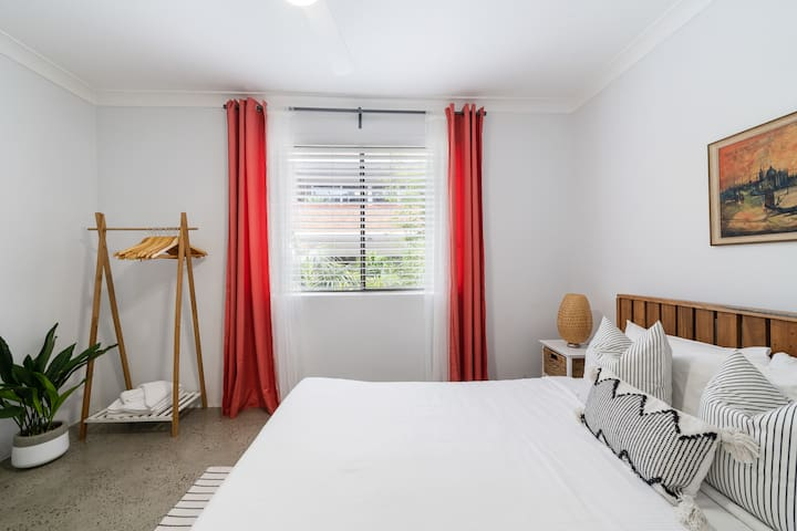 The master bedroom is fitted with a premium timber queen-sized bed and topped with luxury linens.