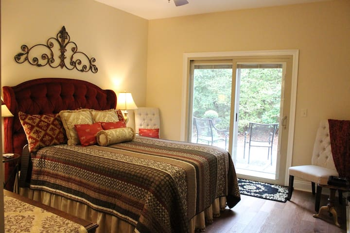 Celebrity Room: Enjoy a touch of class with a red velvet inspired room and a luxury private bath. Sneak out your own sliding door to enjoy nature, while sitting on a deck overlooking the woods.
