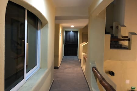 Lighted hallway to condo