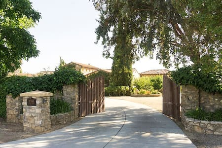 Please check your email for the gate code as it changes often.   Entry the red gates to our home and drive straight back towards the wine barrels